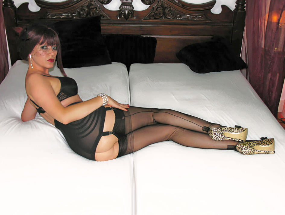 Ladies on a bed in Stockings